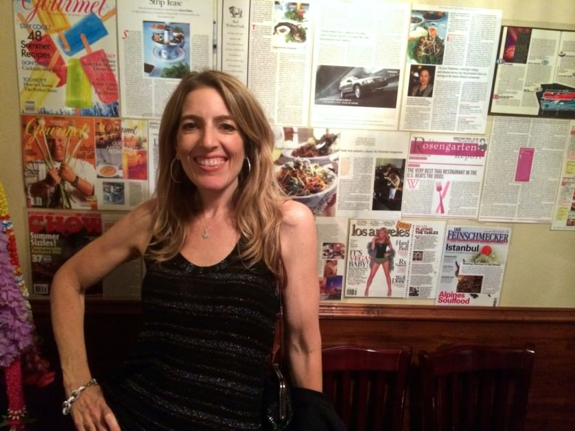 Orna in front of articles at Lotus of Siam